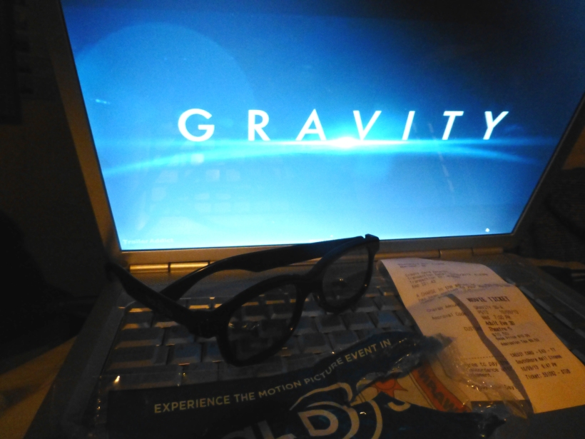 A screen shot of the Gravity preview, ticket stub, and real 3-D glasses w/bag that they came in. PHALL PHOTO 2013